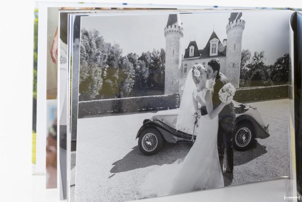 Livre album photo du mariage d'un jeune couple au chateau Agassac à Ludon Médoc dans la région de Bordeaux. Sébastien Huruguen photographe mariage